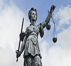 Lady Justice statue holding balance scales and a sword