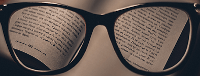 Text in a book looked at through glasses
